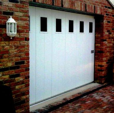 SIDE SLIDING SECTIONAL  GARAGE DOORS